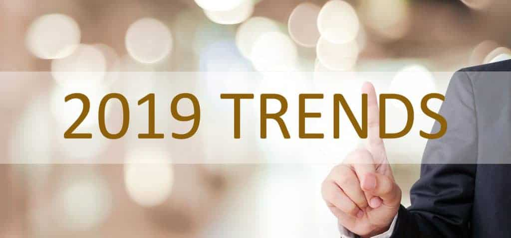 Businessman hand touching 2019 trend over blur office background, banner, 2019 business strategy annual plan, success in business concept