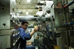 hoffer plastics employee working on machine